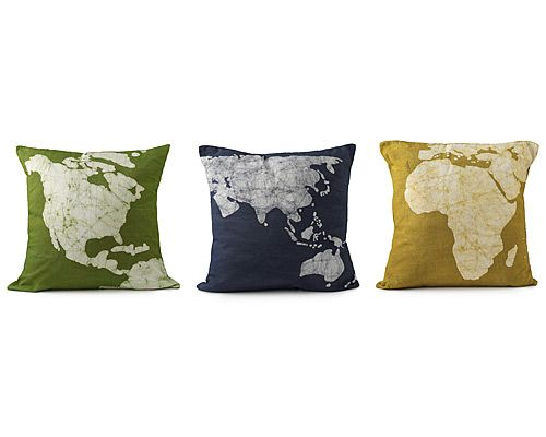 """CONTINENT PILLOWS-SET OF 3  $ 95.00 """"Rest your head close to home or drift off to far away lands with the world map pillows. Either way, you can rest assured that these bright & cheery pillows help the greater good by providing fair wages & development opportunities for artisans in South West India. Pillow cases are made of cotton & decoration is applied using Batik, a traditional Indian art to create patterns on fabric. Set of three pillows. Handmade in India."""""""