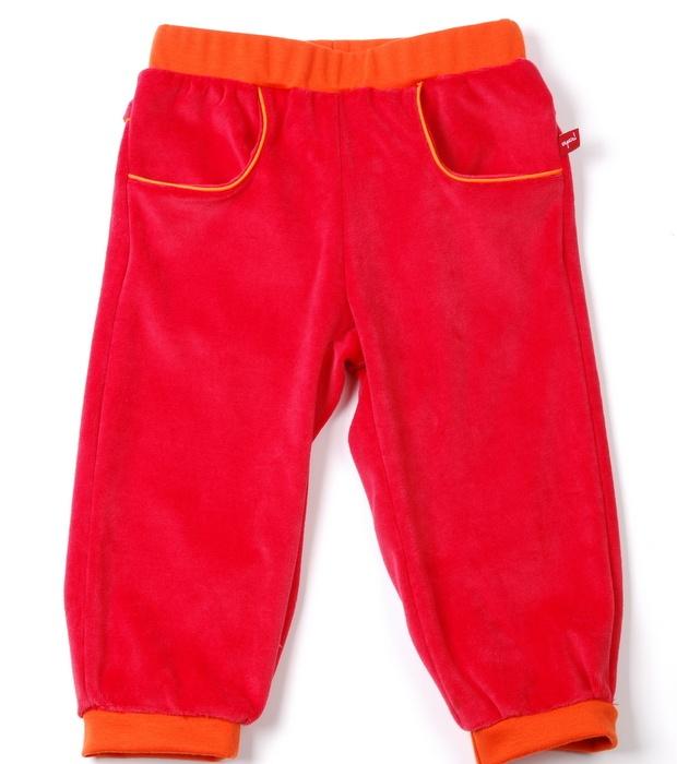 comfy broek : kei toffe broek voor jongens en meisjes gemaakt van nicky velours in rood, afgewerkt met oranje paspel en grappige zakjes met een elastische tailleband zodat zelfs de kleintjes onder ons ze zelf kunnen aantrekken