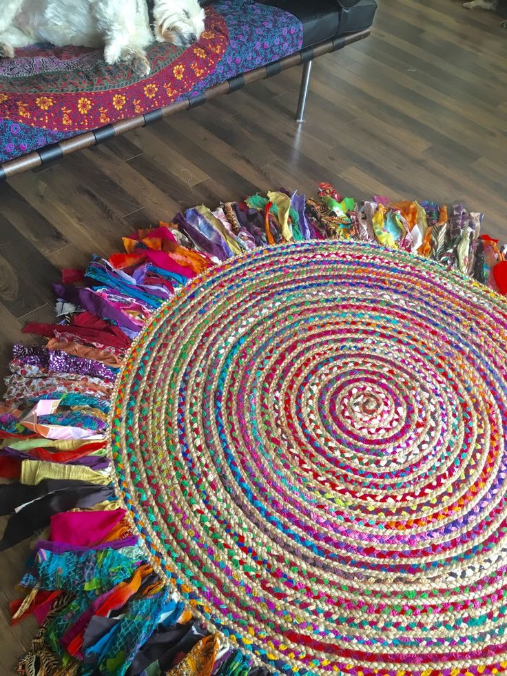 A personal favorite from my Etsy shop https://www.etsy.com/listing/270974973/boho-6-feet-round-braided-rug-one-of-a