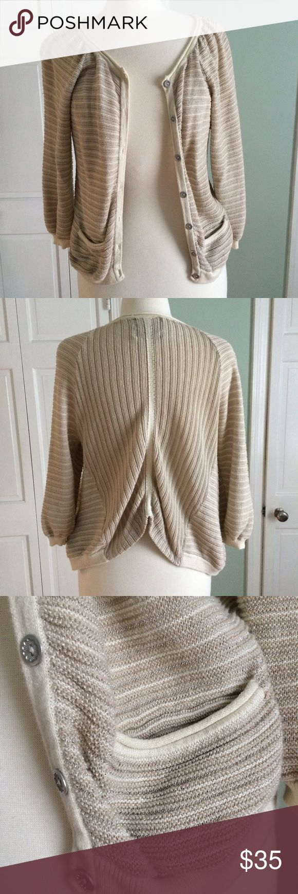 ANTHRO Guinevere cream cardigan EUC cream cardigan sweater with a touch of subtle metallic thread. Buttons work, so do pockets. The easiest sweater to throw over any outfit. Anthropologie Sweaters Cardigans