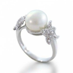 pearl engagement ring. Call me crazy, but I'd rather have a pearl than a diamond any day. Not that I would mind a diamond... : )