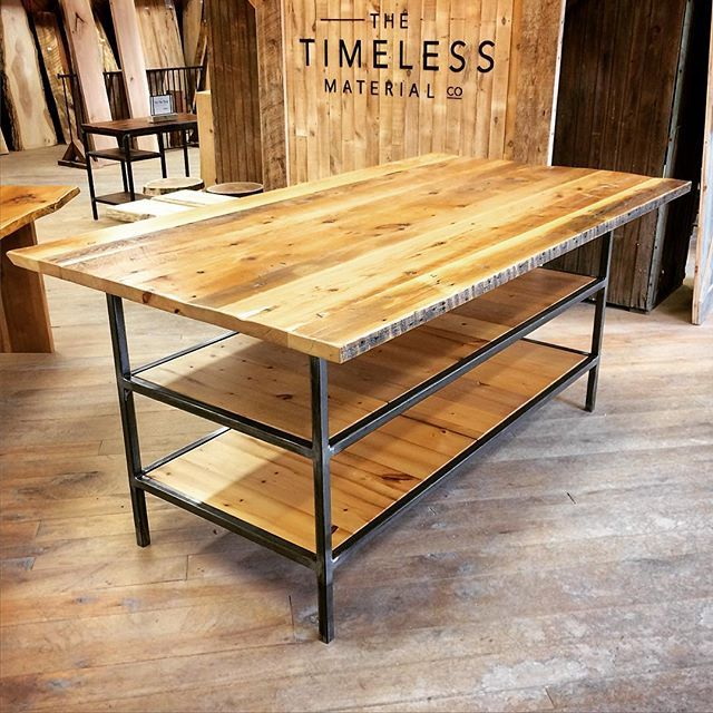We made this custom work table using reclaimed mixed softwood boardstock and remilled mixed softwood flooring on the shelves over a custom metal base. You could get a lot done with a beautiful work surface like this! #interiordesign #woodworking #design #reclaimedwood #industrialdesign
