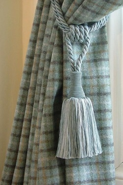 I love my tartan curtains, but I'd never have thought of a tasseled tieback with them