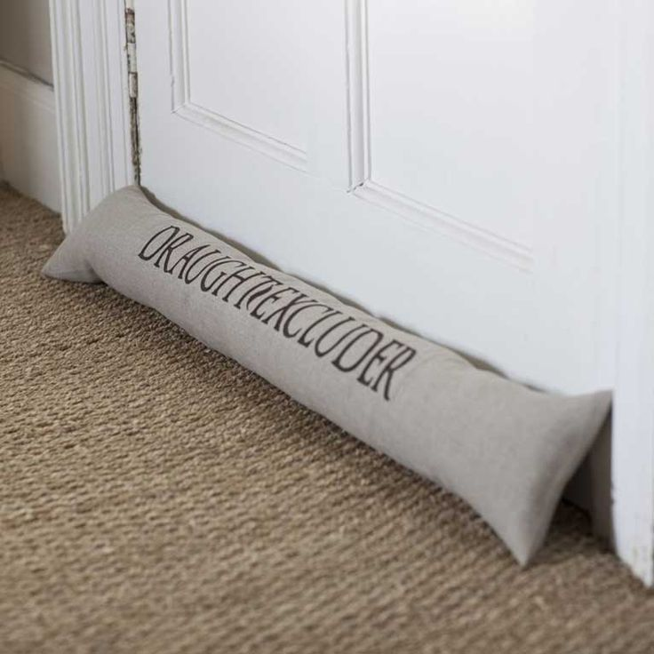 Luxurious pure linen embroidered draught excluder. Inchyra | rustic luxury linens and homewares | Perth Scotland