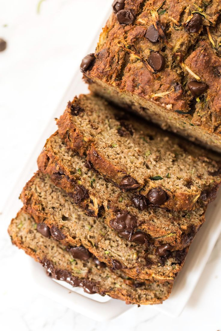 Whip up this HEALTHY Chocolate Chip Zucchini Bread Recipe for breakfast! Packed with protein, healthy fats and fiber, this loaf is nutritious and seriously DELICIOUS! [gluten-free]