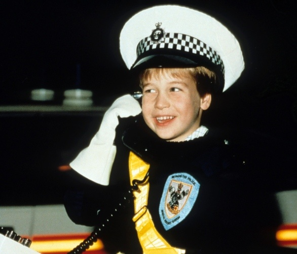 His royal highness is all set to serve! Prince William dons a policeman's uniform while sitting atop a motorbike during a visit to the Windsor police in 1987.