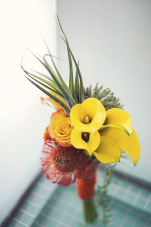 bridal bouquet with succulents, proteas and calla lily, photo by Studio Uma
