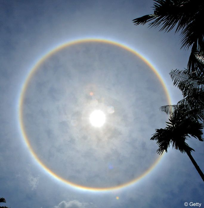 This awesome sight in the skies over Malaysia yesterday wasn't really a rainbow at all but a rare optical illusion called a sundog.