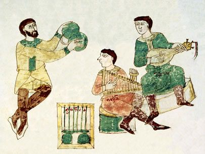 This picture shows three medieval mu​sicians during the 11th century. One of the musicians is playing the cymbals while the other two are playing the lyre and a medieval instrument that looks like a guitar.