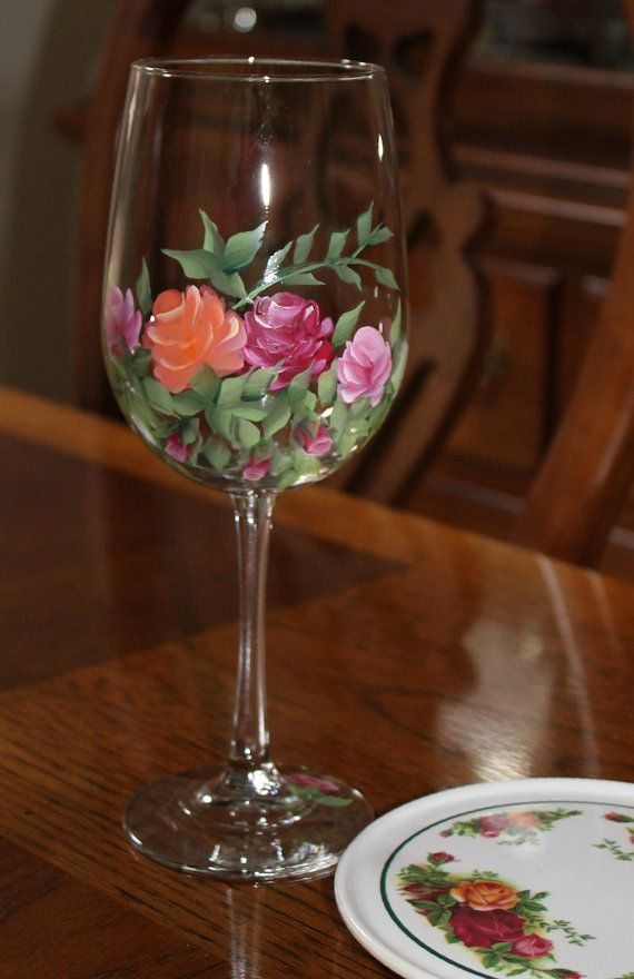 Two elegant hand painted Wine Glasses with Roses typical of an old English country garden. The glasses measure 9 1/4 tall 18.5 oz.  If the