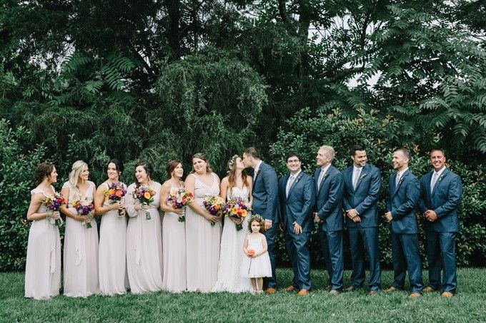 Nuetral bridesmaids and men in Navy - a polished look that really shows off the flowers! #cedarwoodweddings Wild and Free Wildflower Wedding :: Brooke+Jake | Cedarwood Weddings