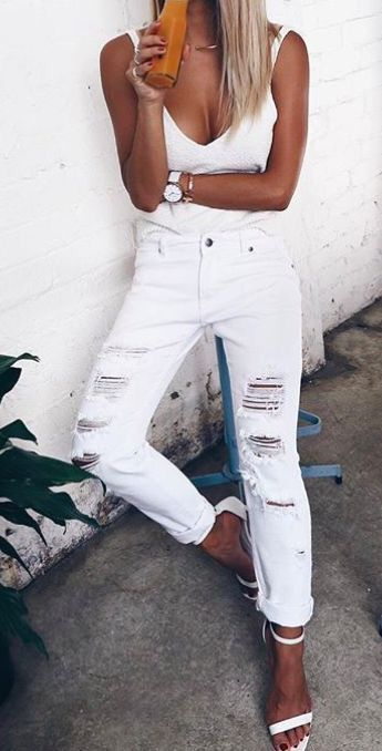 All white everything from the top to the jeans to the shoes, this beb is looking good! We love bold outfit choices like this!