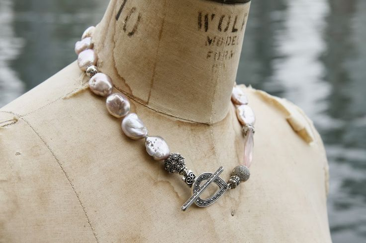 Pale pink meringue pearls with sterling silver accent beads, rose quartz and a marcasite clasp.