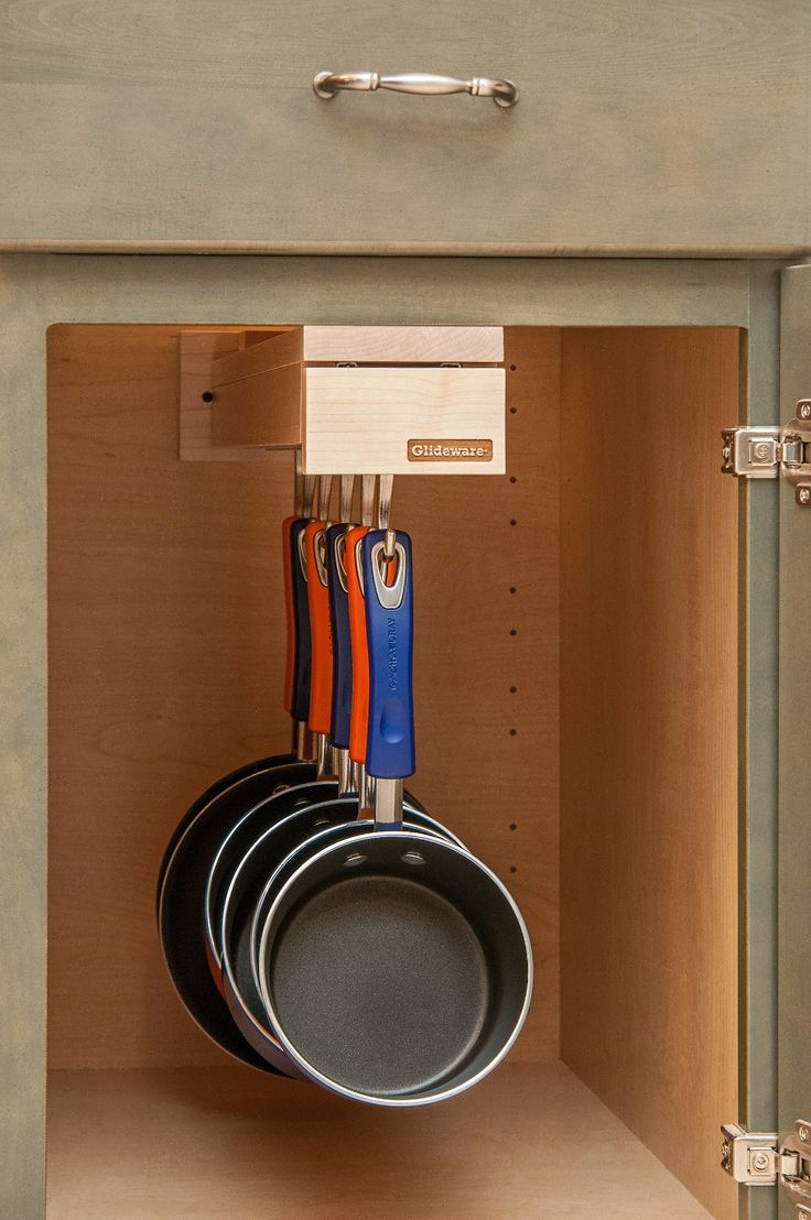 www.glideware.com  Hang your cookware and extend it out of the cabinet for easy access.  Install Glideware in under drawer cabinets and hang smaller skillets and sauce pans.
