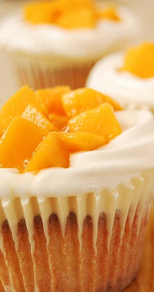 Recipe for Mango Cream Cheese Cupcakes - If you love cream cheese and mango together with a super light and moist, bakery-like cupcake...then this is for you!