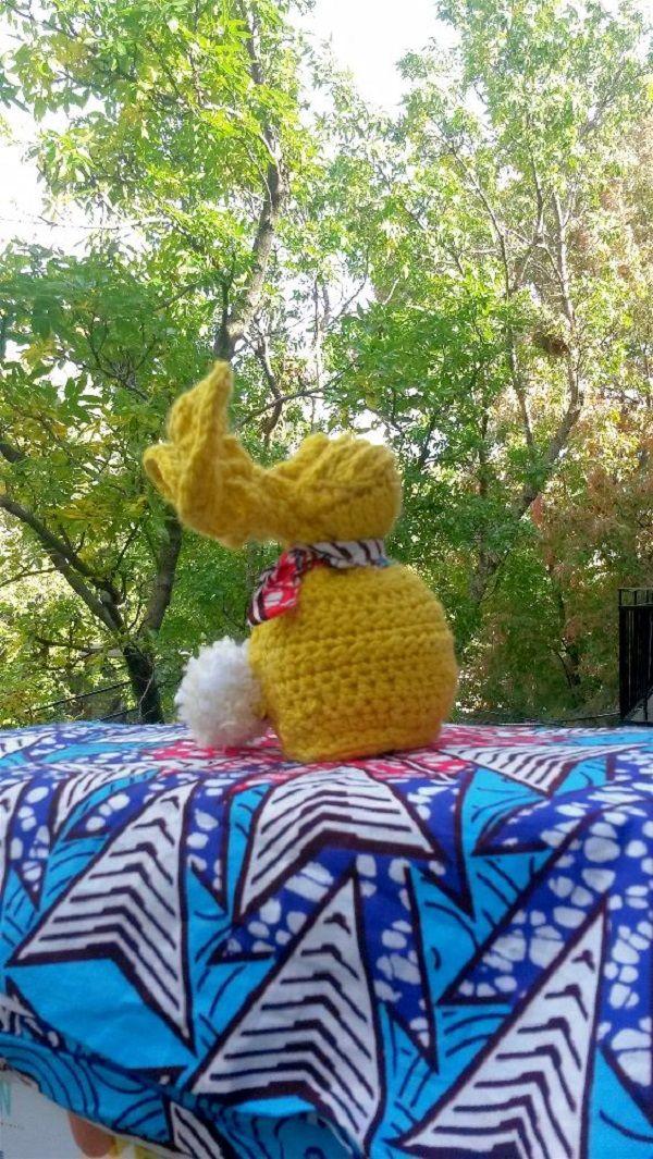 Yellow handmade bunny crochet by the sun !  Look at his wax headscarf  https://www.etsy.com/ca-fr/shop/Zuberlulu