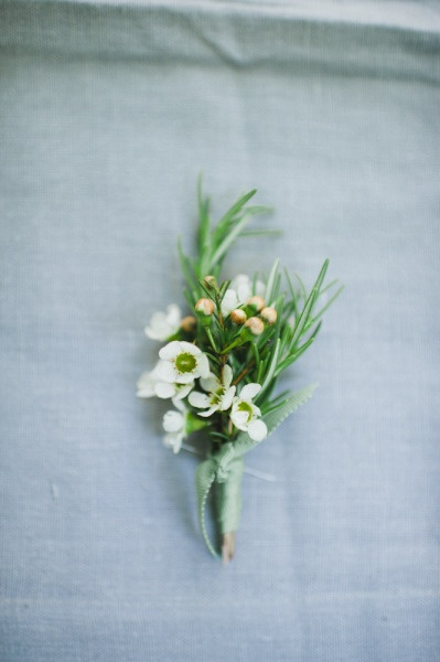 lovely little buttonhole with rosemary and wax flowers
