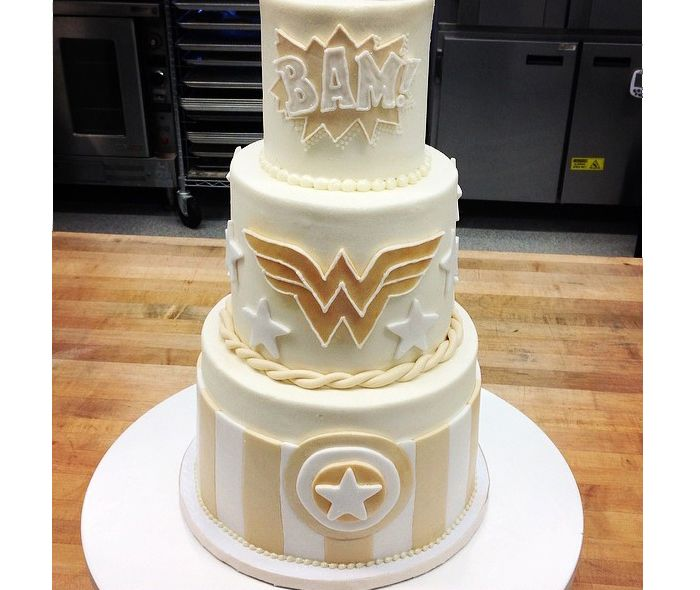Comic book superhero themed white wedding cake.