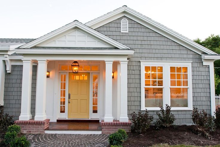 Plain front with columned portico entry, brick porch