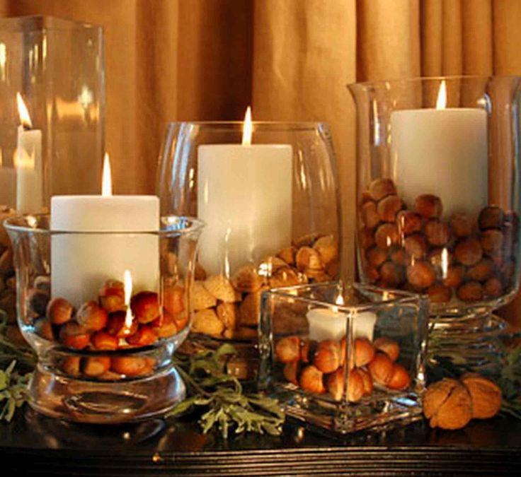Another idea for a party centerpiece on the masculine side. Using tall cylinder vases with nuts or rocks inside with a candle. Simple.