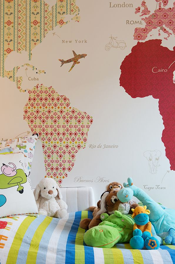 Trace continents onto vintage wallpaper. Love this idea!