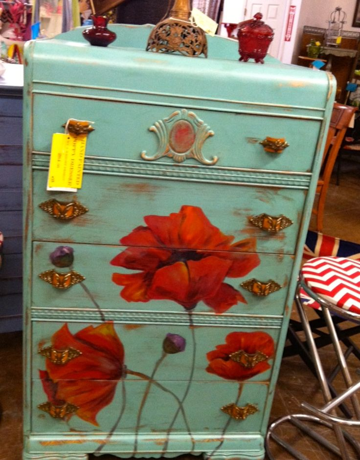 Painted poppy on turquoise waterfall dresser