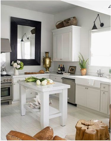 Want to change things up in your kitchen without doing an all-out renovation? One drastic change you can make with very little means is adding a large, framed mirror.