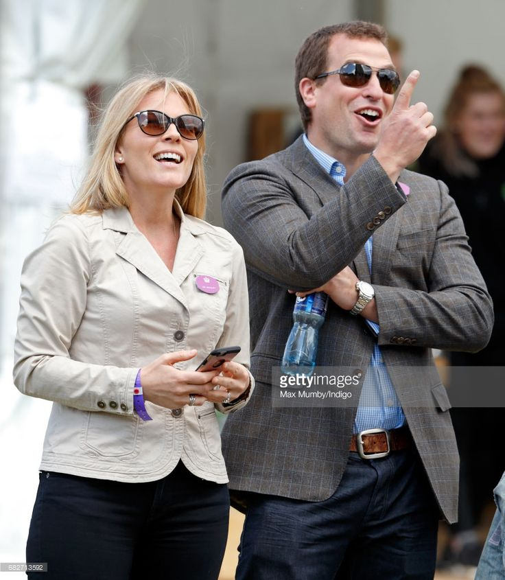 Autumn Phillips and Peter Phillips watch their daughters Savannah and Isla Phillips play on a climbing on day 4 of the Royal Windsor Horse Show in Home Park on May 13, 2017 in Windsor, England.