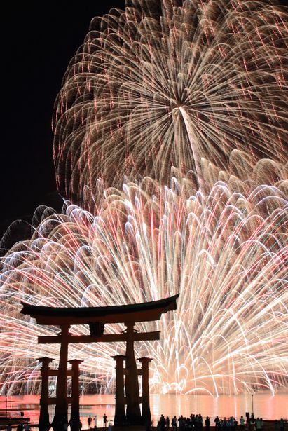 Fireworks at Itsukushima Shrine, Miyajima: photo by yama - Since ancient times, Miyajima Island has been worshipped as a God. This belief, passed down for generations has protected this beautiful site and renowned for being a World Cultural Heritage site today.