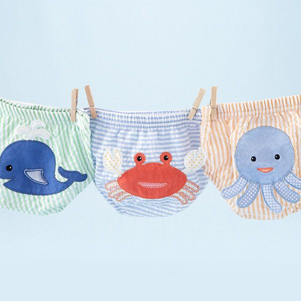 Your baby boy will be making waves when you cover his little bum with these adorable diaper covers. The 3-D details on a wiggly whale, a cute crab an outgoing o