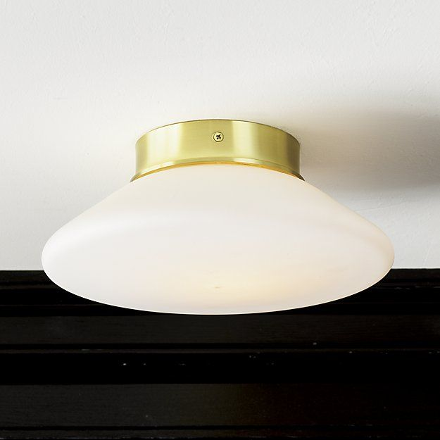 Shop button flush mount lamp. Angular frosted shade diffuses soft light with understated elegance. Trimmed in shiny brass, fixture flushes flat against the wall or ceiling. Another instant classic designed by our friends at Mermelada Estudio.