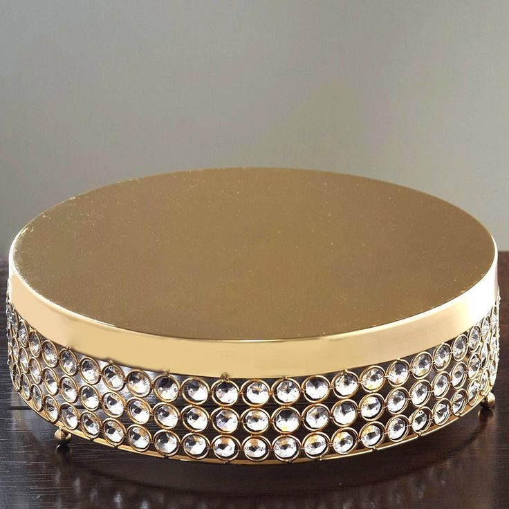 """Grand Wedding Beaded Crystal Metal Riser Cake Stand-Gold-15.5"""" Diameter    A true emblem of luxury and style! Our elegant silver bling cake stand is adorned with sparkly leaded cut crystals wired into place and designed with detailed attention. Add a touch of glitz and glam to your table settings with this bejeweled cake dish that is topped with reflective metal for a beautiful display. The classic round shape coupled with the twinkling crystals and glistening silver finish, make this deluxe…"""