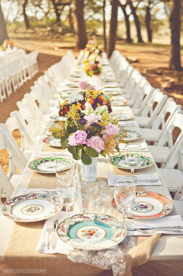 garden party table of miss match china for each setting