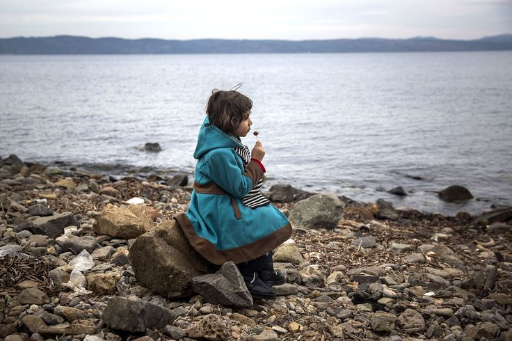 A #Syrian girl enjoys a #lollipop after her arrival on a small boat from the #Turkishcoast to the northeastern #Greekisland of #Lesbos.