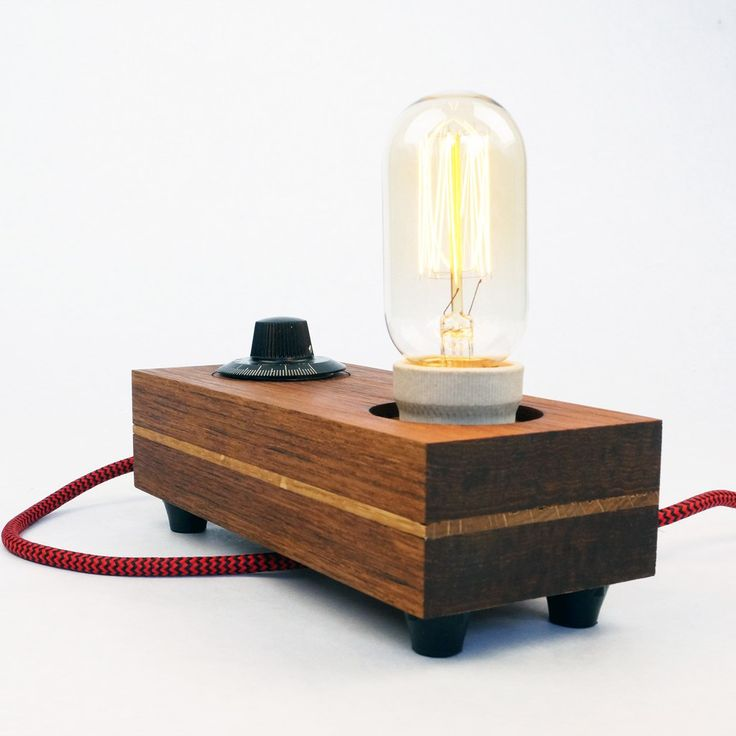 Lamp 'Turn' | This lamp is handcrafted in small series. Made with oiled teak wood. The bakelite knob controls the dimmer and switches the lamp on/off. | #lamp #light #warm #retro #edison #filament #woodwork #wood #design #lighting #brass #bakelite #dimmer #deco #vintage #authentic #tungoil #handmade #handcrafted #upcycling #object #hip #exclusive #oak #unique