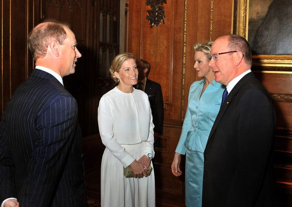 Prince Edward, Earl of Wessex and Sophie, Countess of Wessex talk to Princess Charlene of Monaco and Prince Albert II of Monaco during a reception in the Waterloo Chamber, before the Lunch For Sovereign Monarchs at Windsor Castle, on May 18, 2012 in Windsor, England.