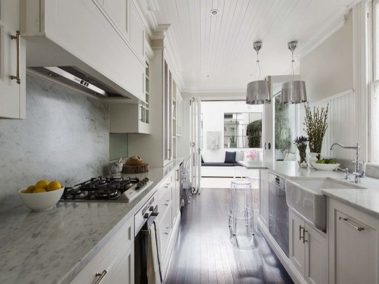 White And Grey Galley Kitchen hamptons-style galley kitchen: white shaker cabinets, undermount