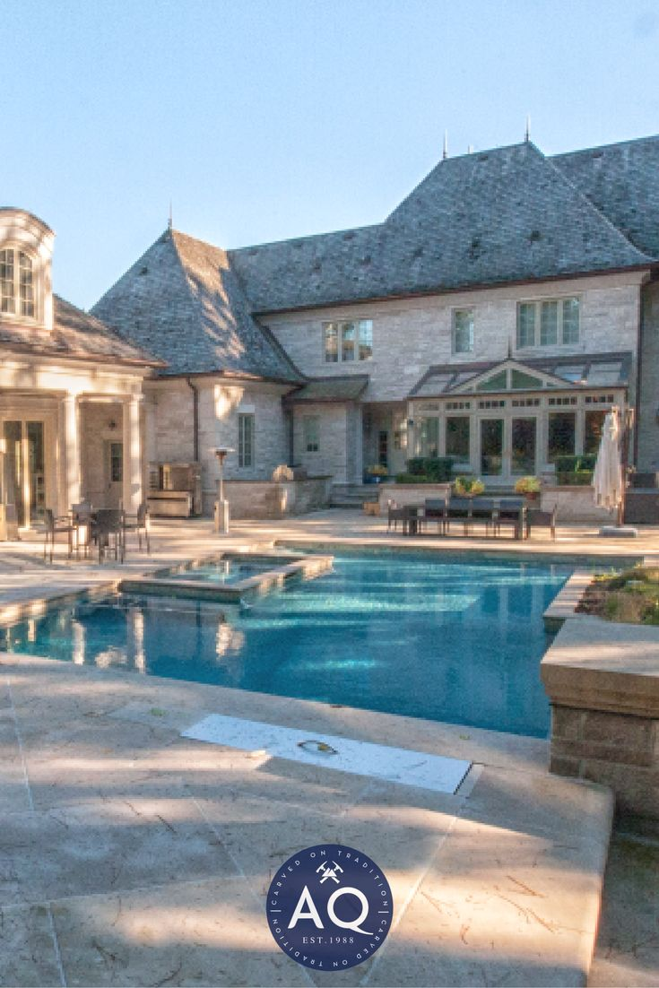 This stunning pool and landscape design in this estate's backyard is full of natural stones. #Allstone