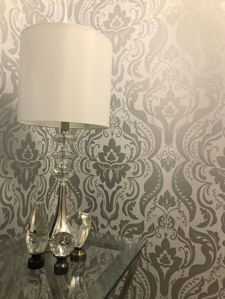 Beautiful wallpaper added to the bedroom for texture, style, and design!