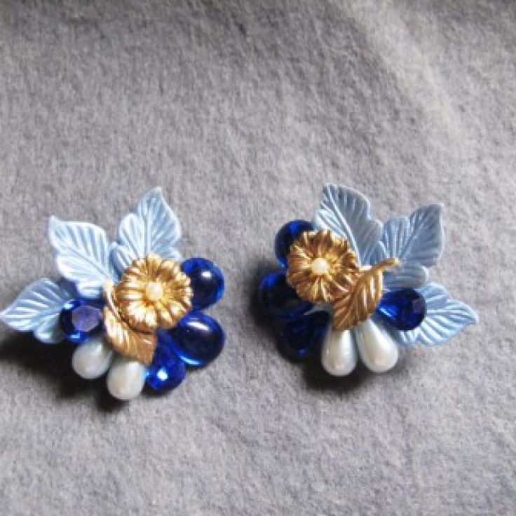 Blue, Gold, Pearl Flower Earrings on Velvet Rose's Pin Up Dressing Room  Stunning earrings very light weight flower in a variety of blues and shapes, leaves, faux pearls, chatons and gold flower, 4 x 3 cm clip ons. signed TWO Sisters
