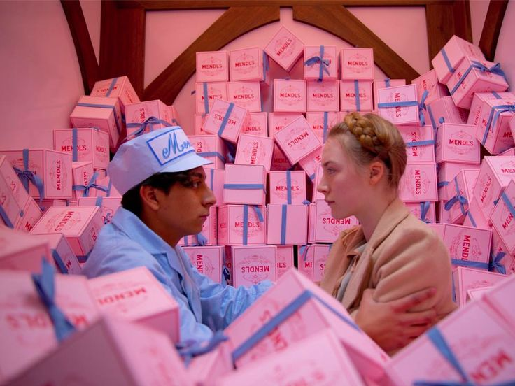 "Tony Revolori as ""Zero"" and Saoirse Ronan as ""Agatha"" in Wes Anderson's THE GRAND BUDAPEST HOTEL"