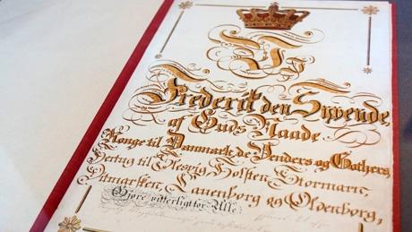 The Danish constitution:   Danmarks Riges Grundlov. I grundloven er det bestemt, at det danske monarki er konstitutionelt