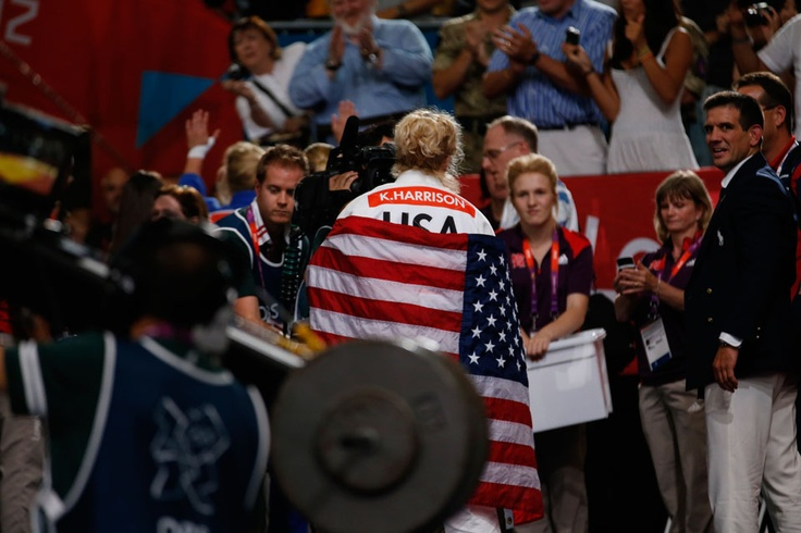 Olympic judo champion Kayla Harrison wraps herself in the United States flag after taking gold in the women's -78kg competition