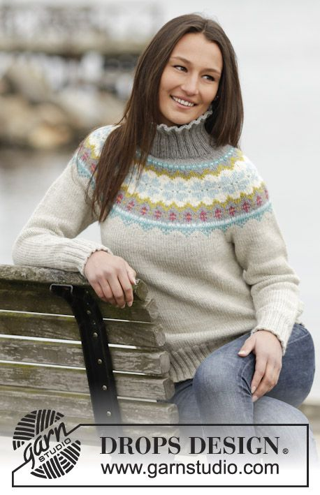 Knitted DROPS jumper with Norwegian pattern, round yoke and high collar in Nepal. Size S-XXXL. Free pattern by DROPS Design.