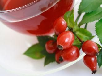 Rosehip tea with glowing red rosehips