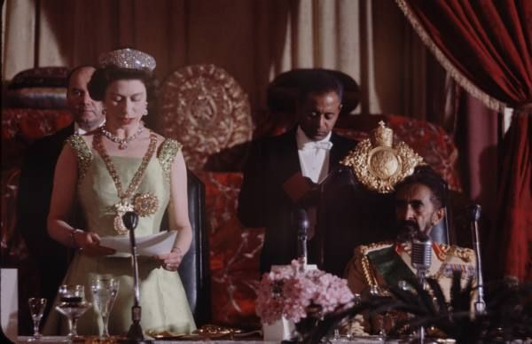 """Elizabeth II, wearing the Chain and Star of the Order of Solomon's Seal (The Ethiopian Empire's Highest Order), addresses Emperor Haile Selassie on the occasion of the State Banquet in her honor, in the Great Throne Hall of the Menelik Palace, in Addis Ababa Ethiopia."""""""