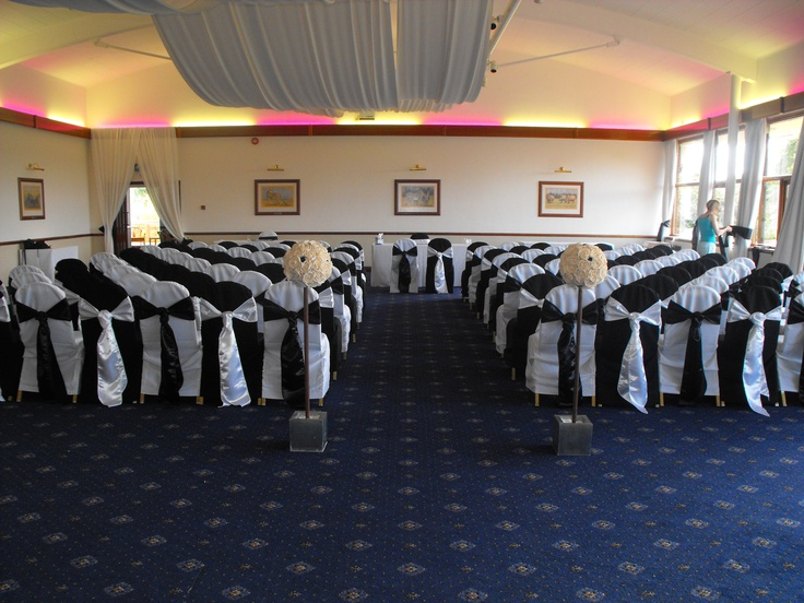 Alternating Black and White Chair Covers and Black and White Satin Cravats
