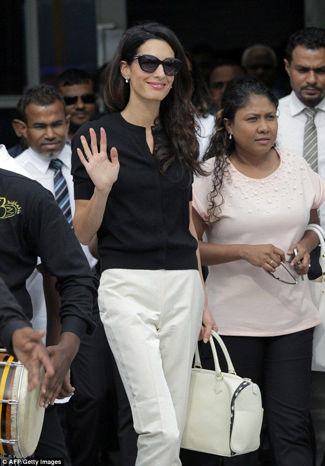 Amal Clooney greeted a large crowd as she touched down in the Maldives capital of Male on Monday, where she is pressing for the release of  jailed former president Mohamed Nasheed