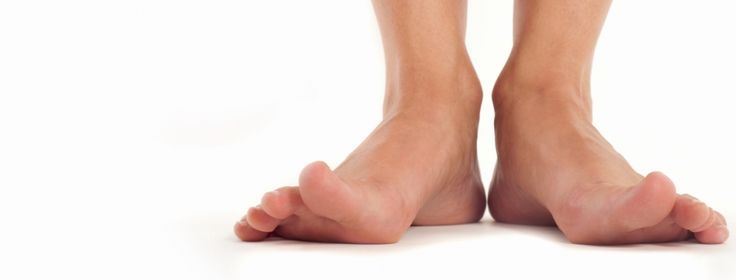 """As many as one in five people have flat feet, which may or may not be accompanied by problems such as pain, tenderness, and swelling.  See what increases your likelihood of what used to be known as """"fallen arches."""""""