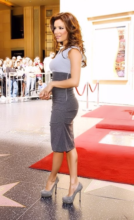 Eva Longoria, my new obsession, I want her hair, body and tan! Post baby that is<3